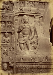 Sculpture on left of arch of façade of Buddhist Chaitya Hall, Cave XIX, Ajanta